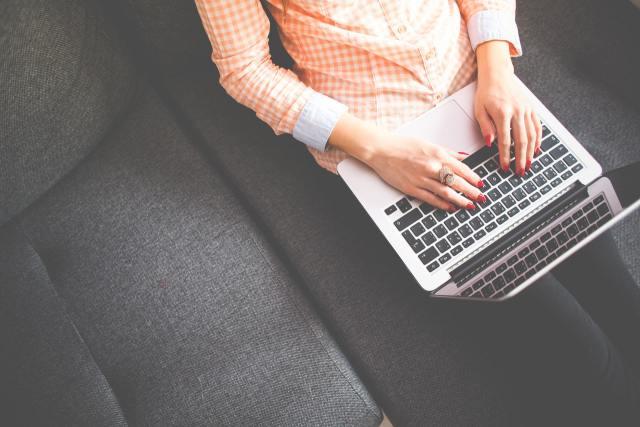 Woman in Orange using laptop