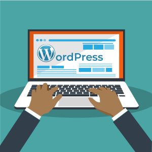 typing on a laptop with Wordpress sight on the screen
