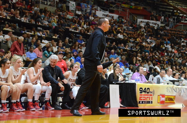 Photo by Nick Baker Clovis West girls' basketball coach Craig Campbell, seen here coaching in his D-1 Valley championship victory at Selland Area over Edison, coached the Golden Eagles to a 26-5 record and is this year's TRAC Coach of the Year.