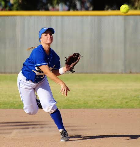 Photo by Nick Baker Clovis shortstop Cayla Broussard rifles a throw to first base. The senior led her team in batting average and a D-1 Valley title.