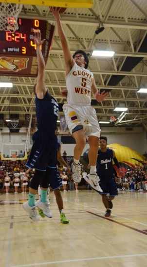 Photo by Nick Baker Clovis West sophomore Adrian Antunez drives to the basket in their D-1 semi-final playoff loss to Bullard. Antunez scored 32 of his team's 68 points and is this year's TRAC Eye of the Tiger award winner, exemplifying a never-give-up spirit.