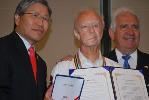 Korean War veteran Charlie Waters receives special recognition at the ceremony. In addition to a medal, he was presented with letters from Governor Jerry Brown's office and from President Barack Obama.