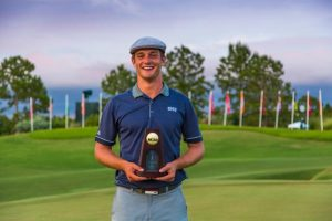 Photo by Matt Marriott/NCAA Photos Bryson DeChambeau, formally of Clovis East, holds up his NCAA individual golf trophy after shooting an 8-under for the tourney.  DeChambeau is a junior at Southern Methodist University.