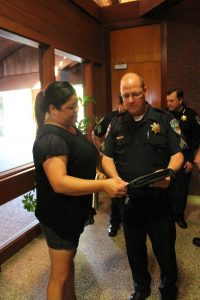 Photo by Ron Sundquist Jaimy Gaines meets with Clovis Police officers after the June 15 meeting.