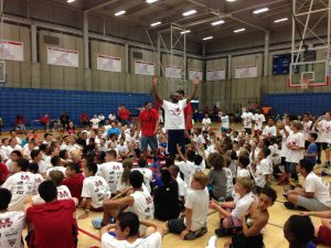 Photo by Paul Meadors Quincy Pondexter celebrates after making a half-court shot at his 3rd annual basketball camp held at Buchanan High School from June 22-25. The camp was attended by over 300 kids from grades K-12 and attracted NBA guests.