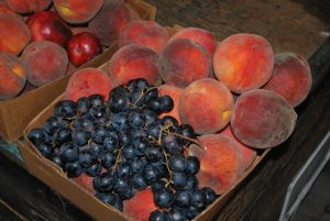 Photos by Valerie Shelton A basket of what's in season at Simonian Farms: juicy peaches and royal red grapes.