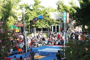 : One pole vault competitor launches himself above the bar at the North American Pole Vaulting Association's championships held in Old Town Clovis during the farmer's market on July 24.