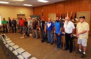Photo by Ron Sundquist Veterans proudly show off their new freedom canes, designed by the Central Valley Woodcarvers and Sequoia Wood Turners.