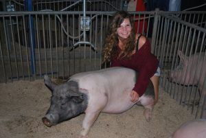 Photos by Valerie Shelton  Kayla Brugetti, a recent Clovis North graduate, with her supreme champion hog, Pancake.