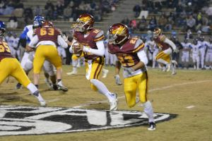 Photo by Jennifer Armstrong Clovis West sophomore quarterback Adrian Martinez, who threw three touchdowns and ran for another, looks to pitch the ball to No. 23 Rodney Wright in a playoff game on Nov. 13.