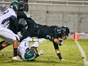Photo by DeAnna Turner Clovis North running back Jayson Lee stretches out for a touchdown in the Broncos 55-25 first round playoff victory over Clovis East. Lee rushed for 117 yards and two touchdowns.