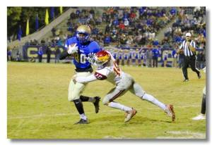 Photo courtesy of Clovis West Clovis wide receiver J.J. Wills tries to break free from Clovis West linebacker Caleb Kelly. Wills had five receptions for 63 yards and Kelly had 11 tackles, a sack and a forced fumble on the night.
