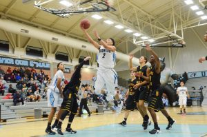 Photo by Nick Baker Senior Jahvon Johnson of Clovis North drives to the hoop in Broncos victory to move into second place in the TRAC at 5-2. Johnson scored 16 points in an emotional night that honored his late brother, Jordan, who passed away unexpectedly in late December.
