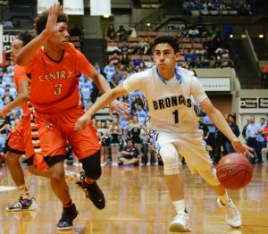 Photo by Nick Baker Central's No. 3 Cam'Ron Wilson plays defense on Clovis North's Domenic Reyes. Wilson scored a game high 25 points in the game include five three-pointers in the Grizzlies first D-1 title in school history.
