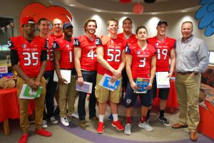 Photo by Valerie Shelton Fresno State football players and Head Coach Tim DeRuyter get ready to read to students at Gettysburg Elementary for Read Across America day, which is Dr. Seuss' birthday.