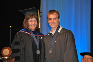 Dean of Instruction Dr. Linda Thomas, with distinguished math, science and engineering graduate Benjamin Vinson.