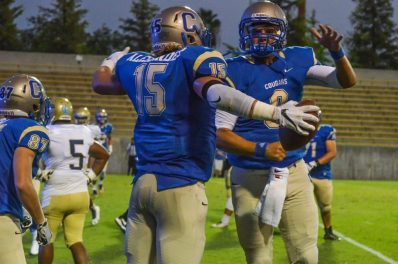 Trey Lake (No. 9) and Clayton Alexander (No. 15) celebrate a touchdown together in the Cougars 36-0 opening season victory. The dynamic duo hooked up for three touchdowns on the night.  [Photo by Nick Baker]