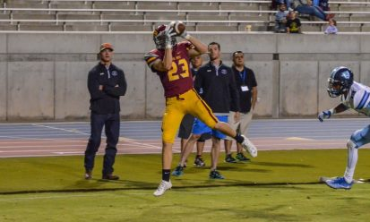 Junior receiver Chad Day catches the game-winning touchdown against Bullard, a 16-yard pass with five minutes left in the fourth quarter. [Photo by Nick Baker]