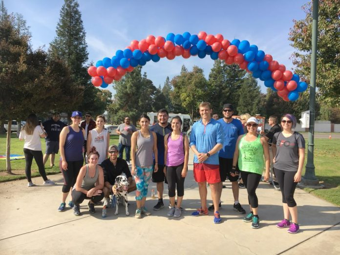 Ryan Stiner with the runners who ran beside him in his last 2.5 mile run from Selma Layne Memorial Park in Fresno to Railroad Park in Clovis. [Photo by Donna Melchor]