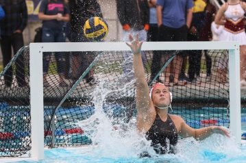 Goalie Hannah Duggins of Clovis West defends a shot against Clovis in the Valley title game. The Golden Eagles were playing in their 20th consecutive final and won their 13th title. [Photo by Nick Baker]