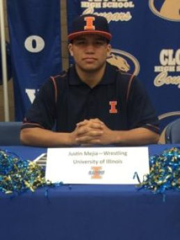 Clovis wrestling star and three-time state champion Justin Mejia signs his National Letter of Intent with the University of Illinois. [Contributed photo]