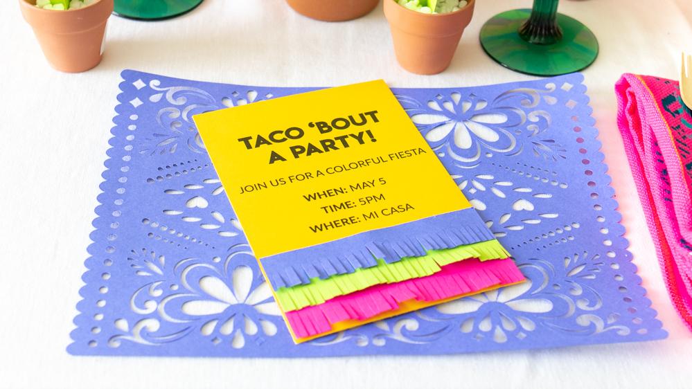 paper fringe invitation on paper placemat