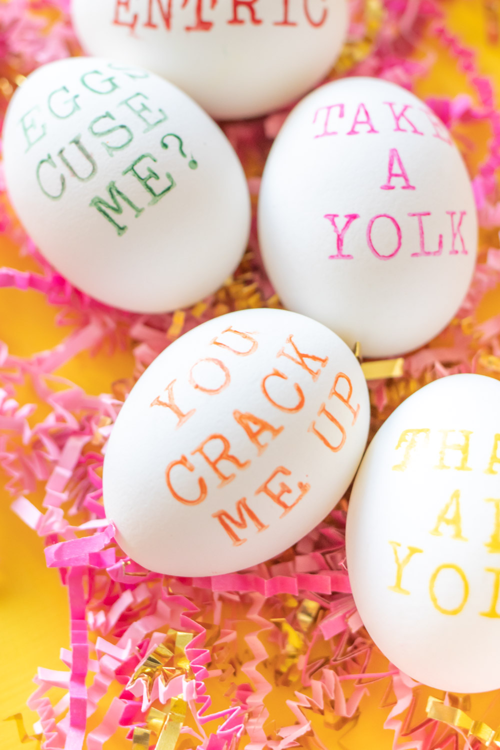 closeup of hand stamped easter egg in orange
