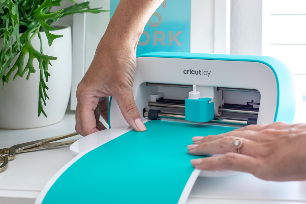 loading blue vinyl into cutting machine