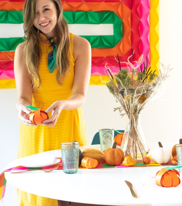 Use vibrant cardstock from the ASTROBRIGHTS Mega Collection Retro Cardstock Assortment to make DIY paper decor this Thanksgiving! No matter the celebration, this easy 3D paper mural, woven table runner and pumpkin treat placecards will be perfect for decorating your table for guests. You'd be amazed what you can make with a pack of cardstock! #ad #papercrafts #murals #paperdecor #paperparty #thanksgiving #thanksgivingdiy #thanksgivingcrafts #holidaycrafts #partycrafts #diyparty #papermural #treatbags #diyplacecards
