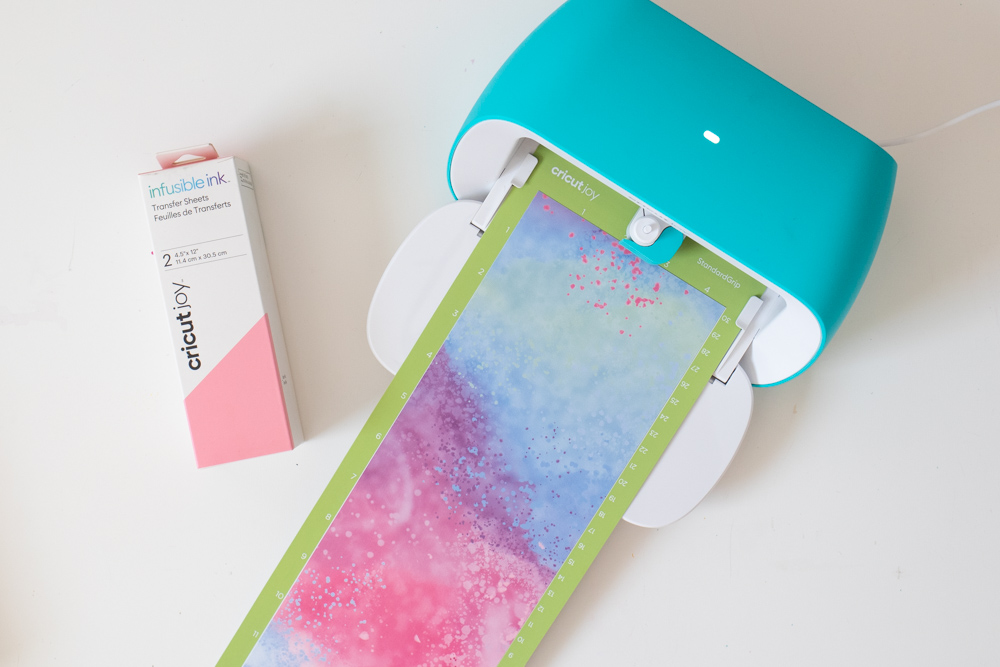 loading Infusible Ink into Cricut Joy for gift packaging