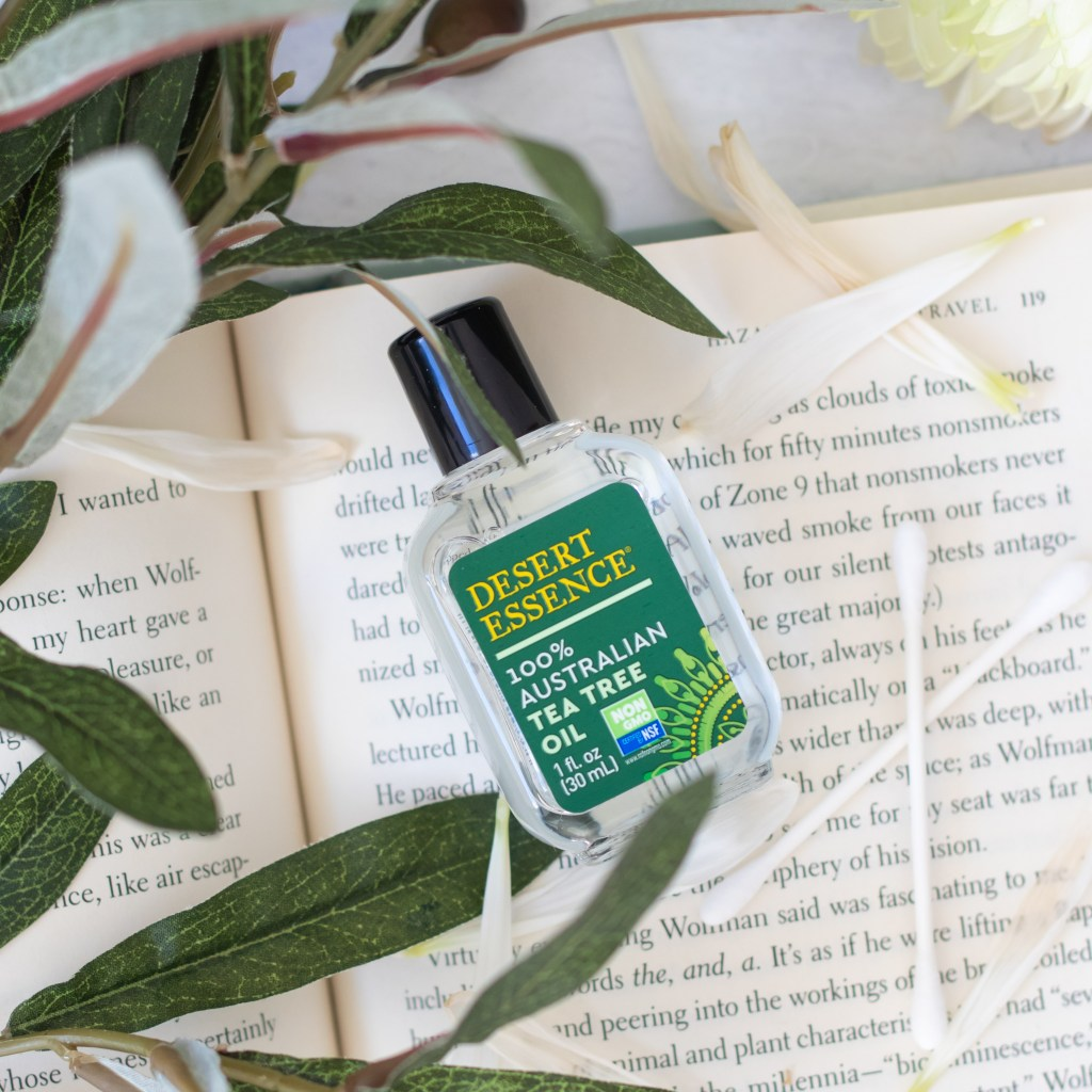 oil bottle on book with greenery for product photography