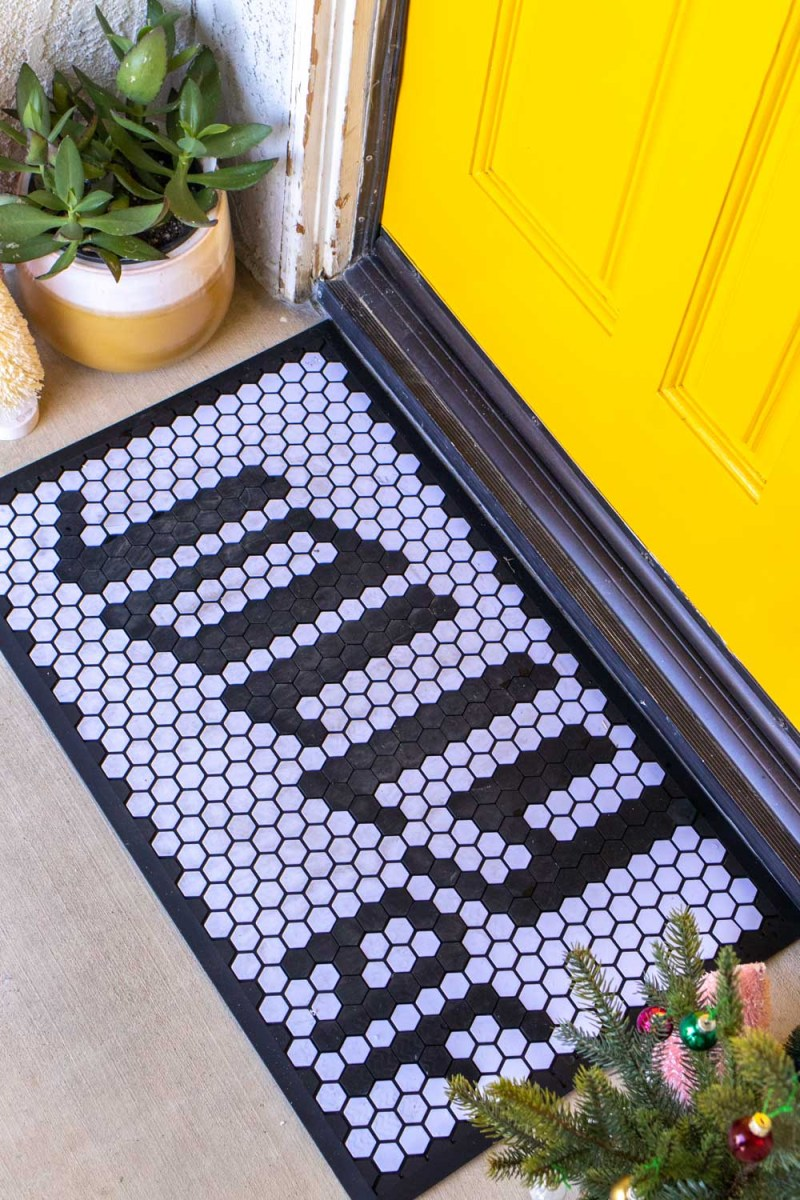 customizable doormat with holiday message in front of modernized front door