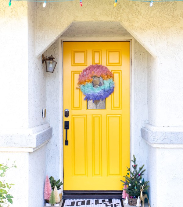 bright yellow modernized front door with modern door hardware