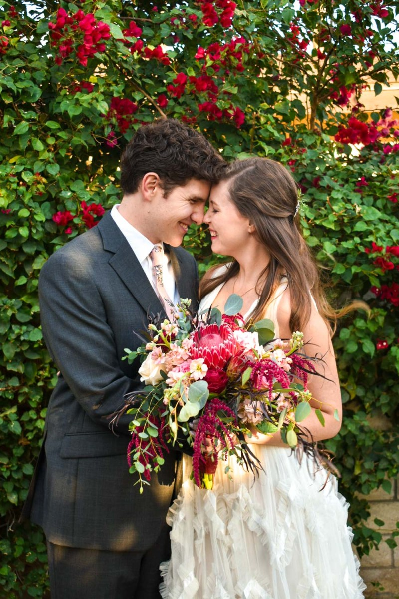 bride and groom with flowers