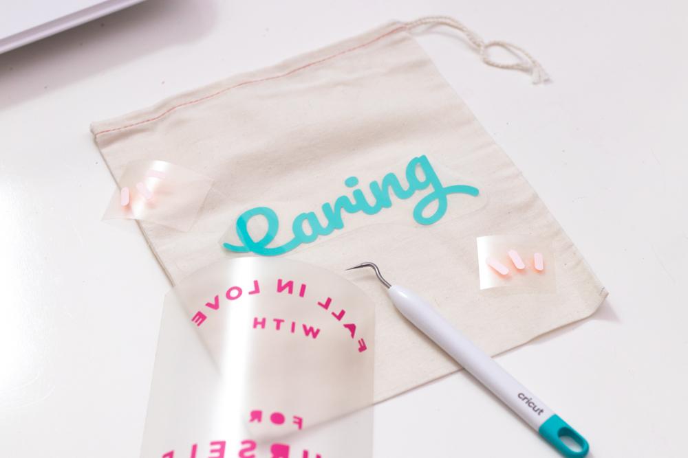 weeding and arranging vinyl on gift bag