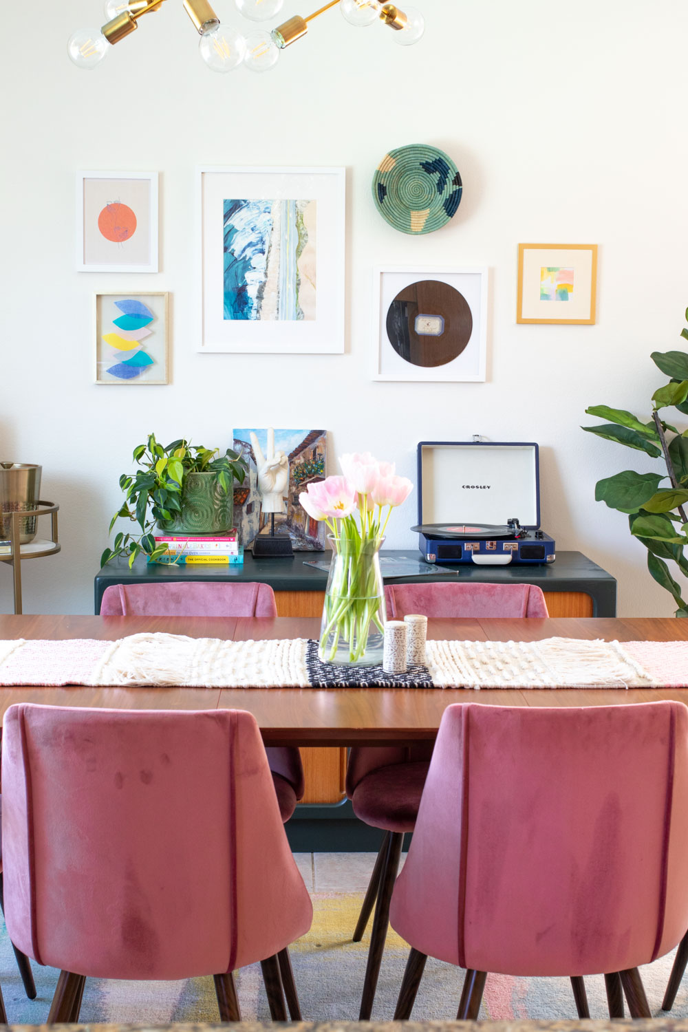 colorful dining room featuring wall art with tissue paper