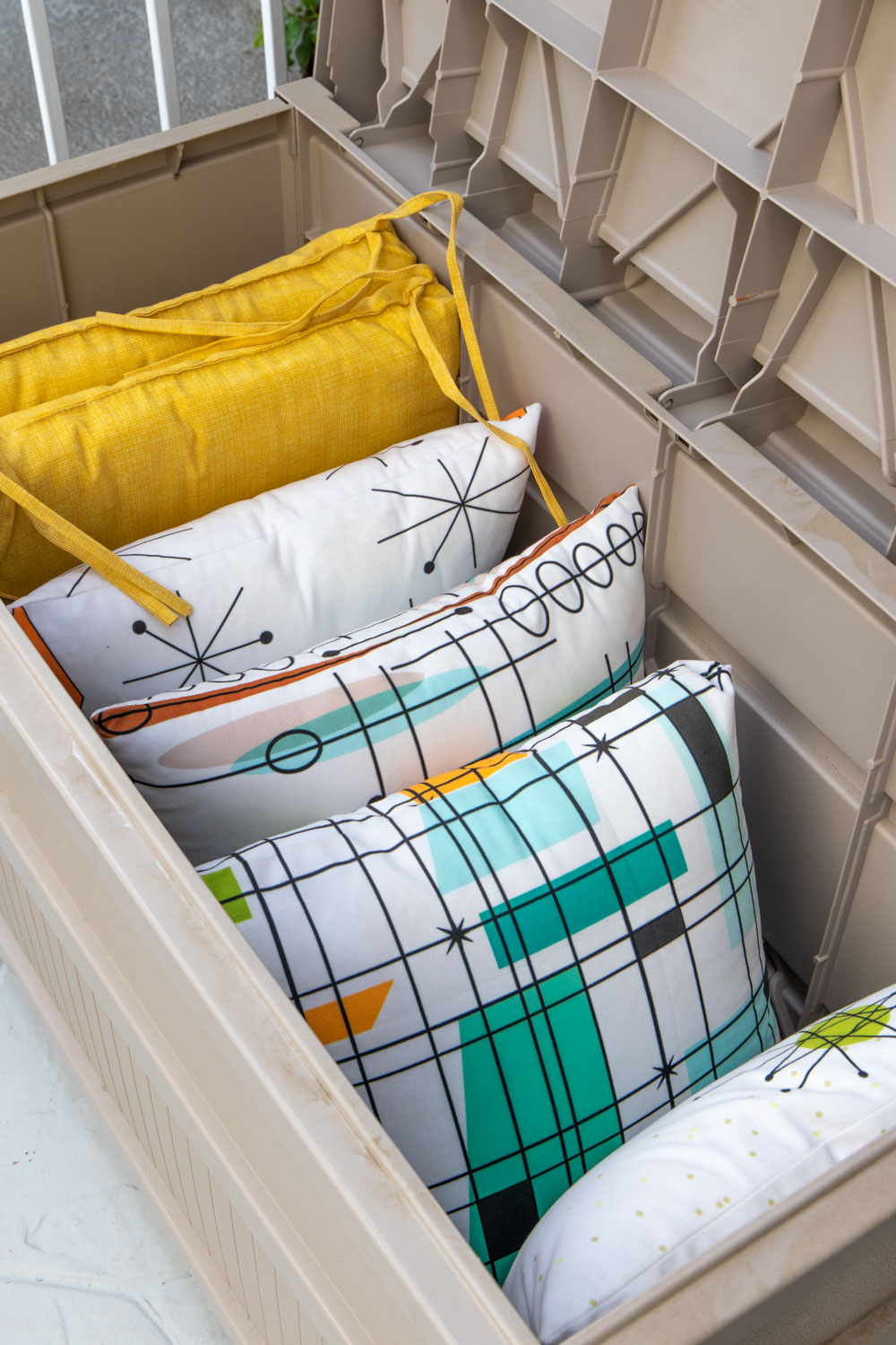 inside of deck box filled with pillows