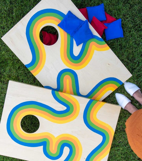 overhead view of cornhole makeover with painted retro design