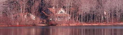 my fictional image of camp nanowrimo: house on lake surrounded by bare trees