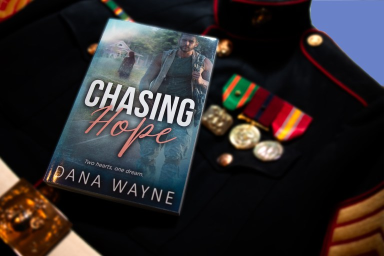 Photo of Chasing Hope book setting on Marine dress blue uniform