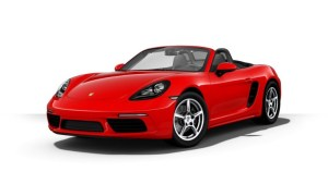 Image of a red Porsche convertible with black interior and the top down