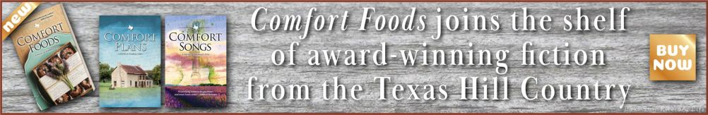 Rectangular banner ad: Comfort Foods joins the shelf of award-winning fiction from the Texas Hill Country; buy now. Image has old wooden texture, with the three covers of the Comfort series on the left.