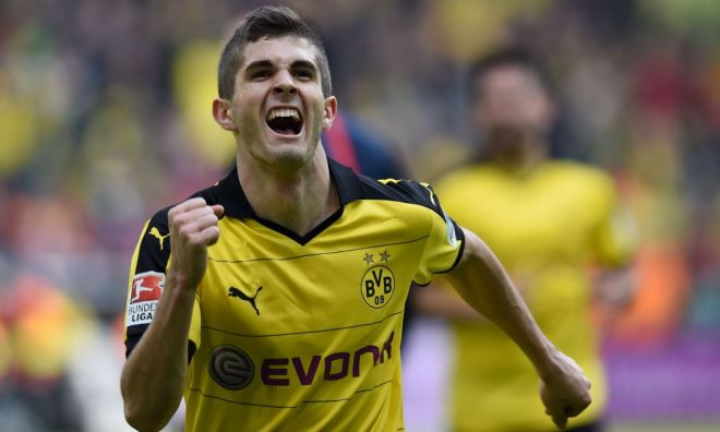 Dortmund's midfielder Christian Pulisic celebrates scoring the 1-0 goal during the German Bundesliga first division football match BVB Borussia Dortmund vs Hamburg SV in Dortmund, western Germany, on April 17, 2016. / AFP / PATRIK STOLLARZ / RESTRICTIONS: DURING MATCH TIME: DFL RULES TO LIMIT THE ONLINE USAGE TO 15 PICTURES PER MATCH AND FORBID IMAGE SEQUENCES TO SIMULATE VIDEO. == RESTRICTED TO EDITORIAL USE == FOR FURTHER QUERIES PLEASE CONTACT DFL DIRECTLY AT + 49 69 650050 (Photo credit should read PATRIK STOLLARZ/AFP/Getty Images)
