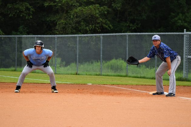 Todd Koenitz holds Brian Breiholz at first on 8/29/2020