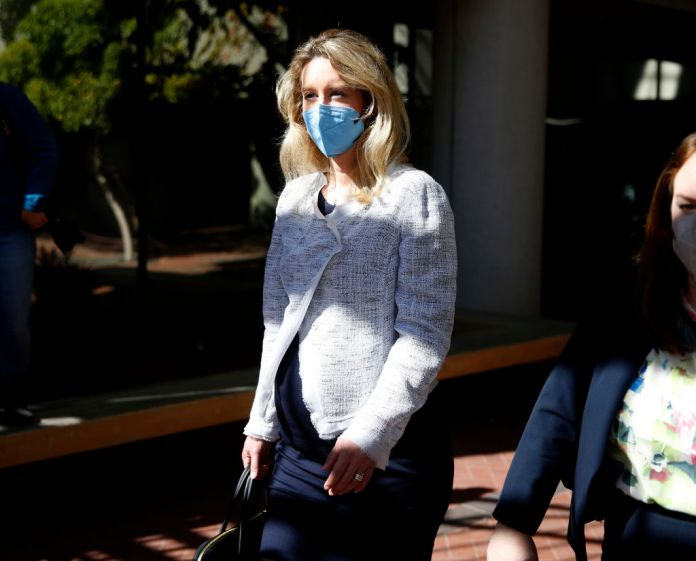 Theranos founder Elizabeth Holmes leaves the Robert F. Peckham Federal Building with her defense team in downtown San Jose, California, on Tuesday, May 4, 2021.
