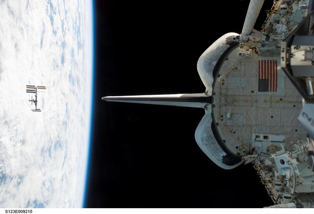 NASA's Space Shuttle Endeavour orbits near the International Space Station in 2008. The ISS orbits somewhat higher than 200 miles above the Earth's surface, roughly the distance from New York to Boston.