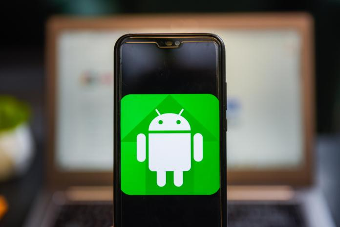 Android logo seen on a phone screen