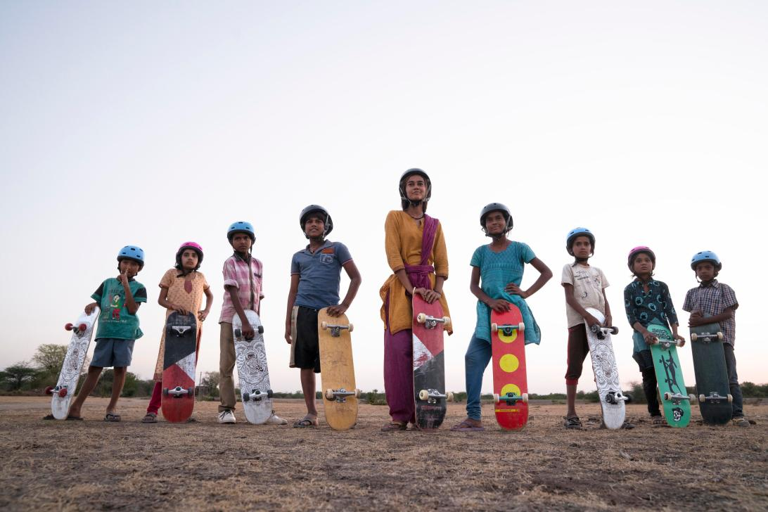 Kids stand with their skateboards