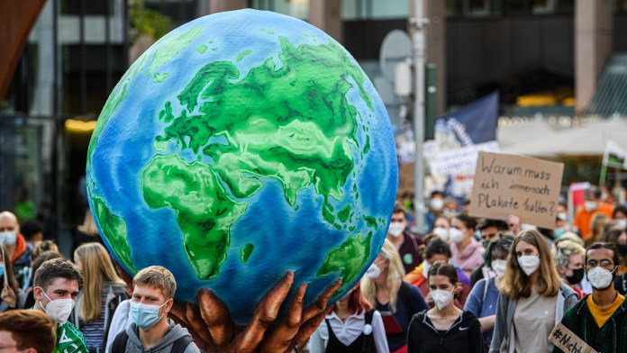 Protestors march in Dusseldorf, Germany, during the September 2021 climate strike