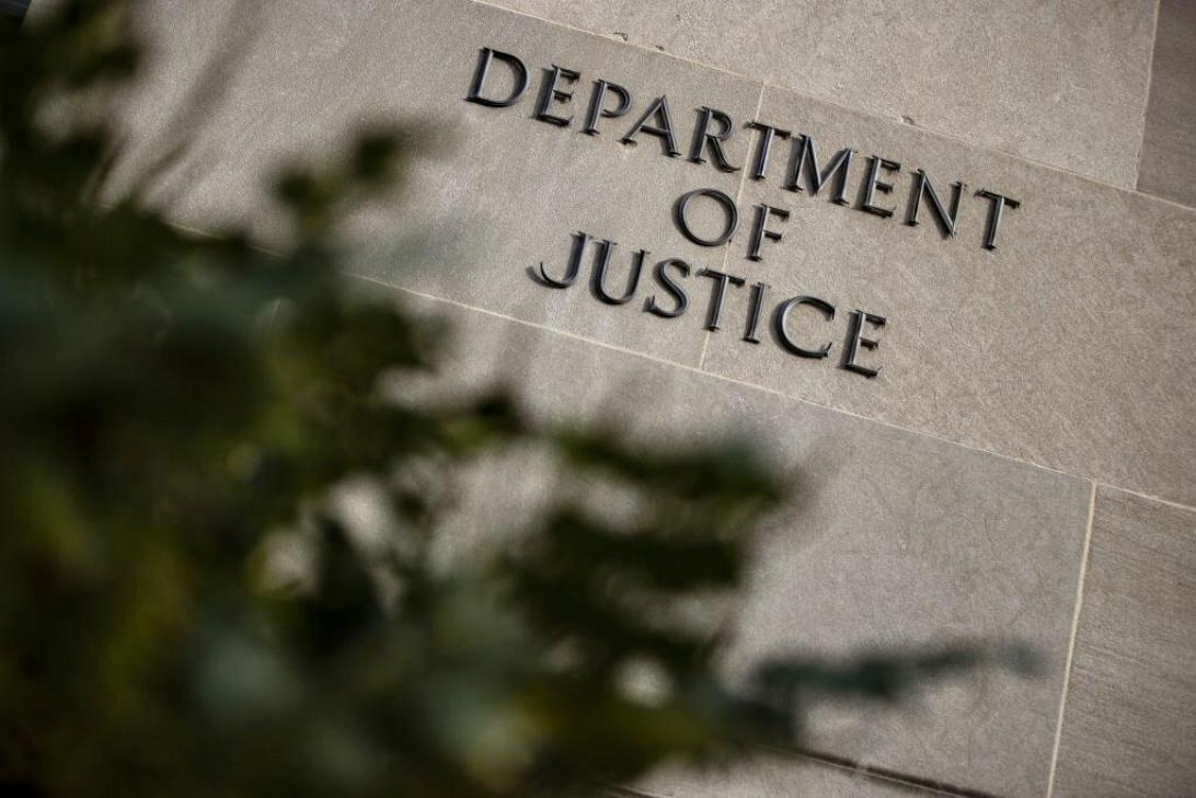Sign at the US Department of Justice headquarters in Washington, DC